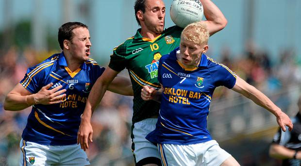 Graham Reilly, Meath, in action against Paul McLoughlin, left, and Mark Kenny, Wicklow