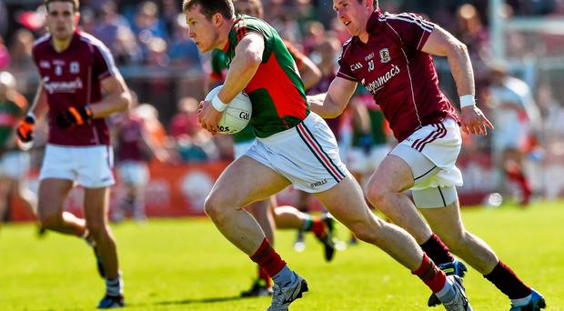 Donal Vaughan, Mayo, in action against Gary Sice, Galway