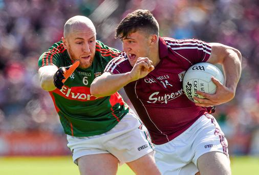Damien Comer, Galway, in action against Tom Cunniffe, Mayo