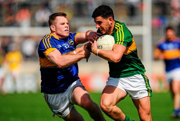 Michael Geaney, Kerry, in action against Ger Mulhaire, Tipperary