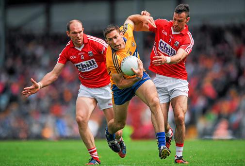 Gary Brennan, Clare, in action against Alan O Connor, left, and Kevin O Driscoll, Cork