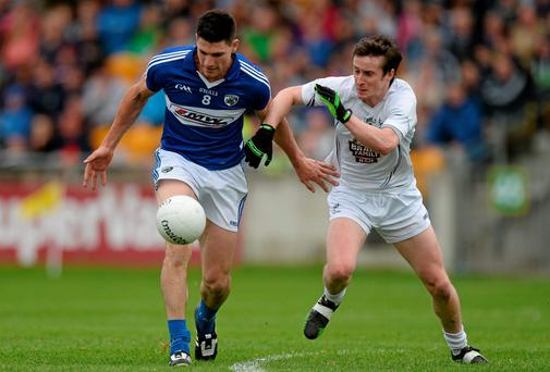 Brendan Quigley, Laois, in action against Ollie Lyons, Kildare