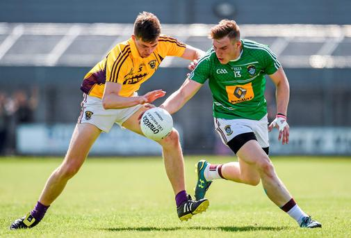 Kieran Martin, Westmeath, in action against Naomhan Rossiter, Wexford