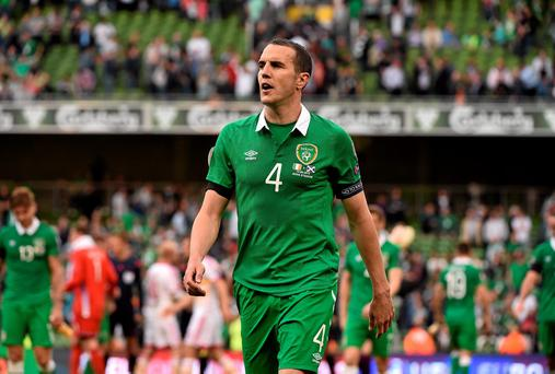 Ireland captain John O'Shea walks off the pitch at the end of the game