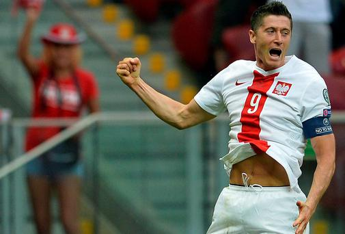 Poland's Robert Lewandowski celebrates after scoring a goal against Georgia