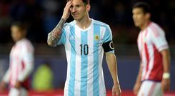 Argentina's forward Lionel Messi reacts during their 2015 Copa America football championship match against Paraguay