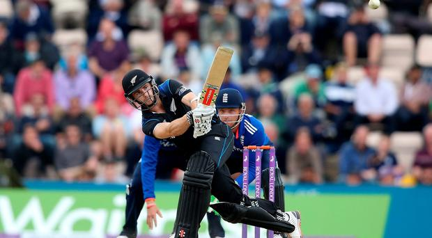 Kane Williamson of New Zealand hits out with Jos Buttler of England looking on