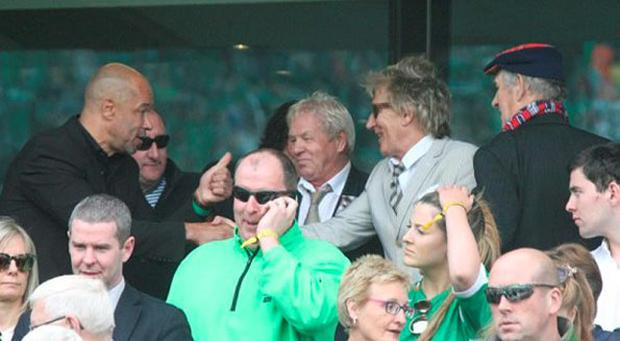 Paul McGrath meets Rod Stewart during the game