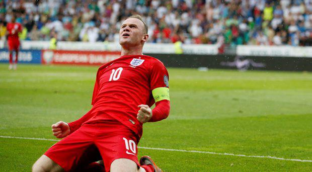 England's Wayne Rooney celebrates after scoring their third goal