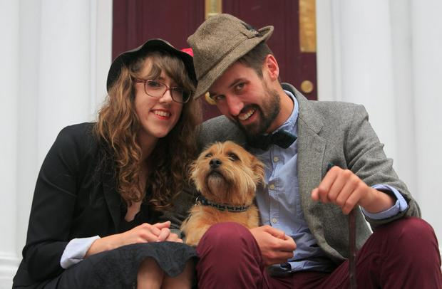 Tia Tilly from Berlinm, Conor Mulvagh from Donnybrook with Rory the shitsu fox terrier during Bizzare Bloomsday Brunch as part of the Bloomsday Festival on North Great Georges street, Dublin