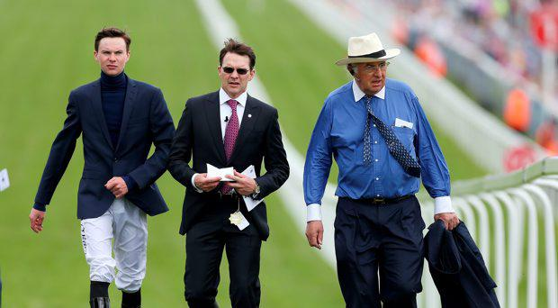 Trainer Aidan O'Brian (centre) with Joseph O'Brien (left) on Ladies Day of the 2015 Investec Derby Festival at Epsom Racecourse, Epsom