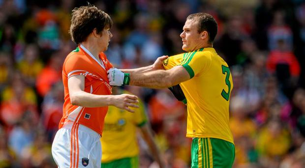Andrew Murnin, Armagh, and Neil McGee, Donegal, pulling at each others shirts. Ulster GAA Football Senior Championship Quarter-Final, Armagh v Donegal. Athletic Grounds, Armagh. Picture credit: Oliver McVeigh / SPORTSFILE