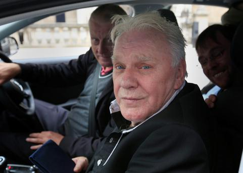 Freddie Starr leaves the High Court in London at the start of a slander and libel claim against a woman who says he groped her when she was in the audience at a Jimmy Savile show when she was a 15-year-old Credit: Jonathan Brady/PA Wire