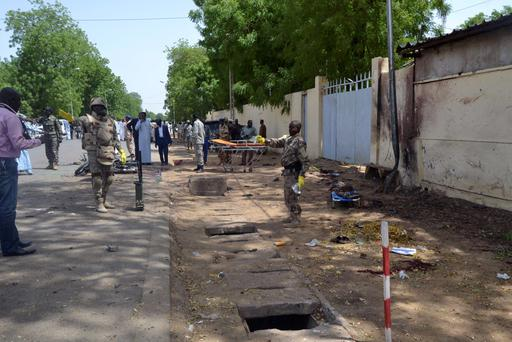Security officers secure the site of a suicide bombing in Ndjamena, Chad REUTERS/Moumine Ngarmbassa