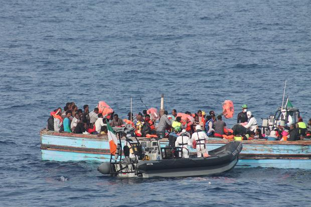 Irish Defence Force photos showing crew members on the LE Eithne and some of the 360 migrants rescued by the vessel from a wooden barge in the Mediterranean