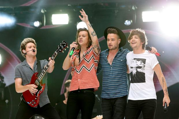 (Left - right) Niall Horan, Harry Styles, Liam Payne and Louis Tomlinson of One Direction perform on stage during Capital FM's Summertime Ball at Wembley Stadium, London.