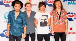 One Direction (left to right) Liam Payne, Niall Horan, Louis Tomlinson and Harry Styles backstage at the Capital FM Summertime Ball held at Wembley Stadium, London.