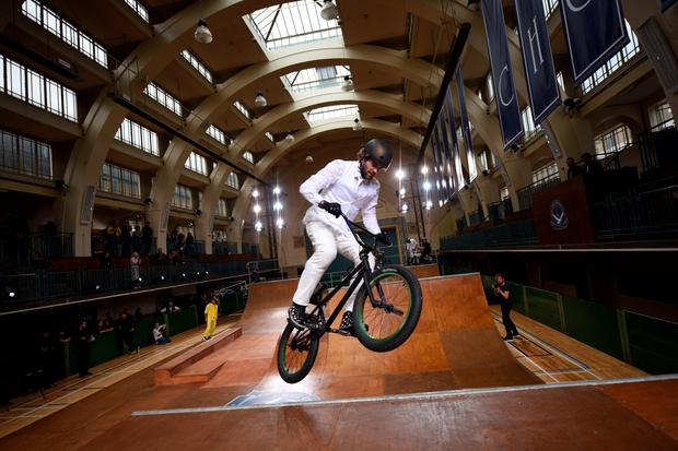A BMX rider performs in Seymour Leisure Centre at a presentation for designer British designer Jimmy Choo on the fourth day of the Spring/Summer 2016 London Collections Men fashion event in central London, on June 15, 2015. AFP PHOTO / OLI SCARFFOLI SCARFF/AFP/Getty Images