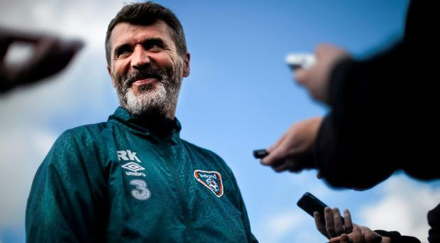 Republic of Ireland assistant manager Roy Keane grins to himself