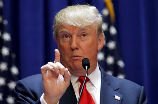 U.S. Republican presidential candidate, real estate mogul and TV personality Donald Trump makes a point as he formally announces his campaign for the 2016 Republican presidential nomination during an event at Trump Tower in New York June 16, 2015. REUTERS/Brendan McDermid