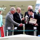 Charles, Prince of Wales and Camilla, Duchess of Cornwall present the trophy to the winning connections of Gleneagles including trainer Aidan O'Brien (right) after victory with Jockey Ryan Moore in the St James's Palace Stakes