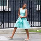 Malia Ann Obama, daughter of US First Lady Michelle Obama, reacts as she arrives in Downing Street in London