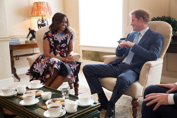 U.S. first lady Michelle Obama speaks with Prince Harry during their meeting at Kensington Palace in London June 16, 2015. REUTERS/Amanda Lucidon/The White House/Handout via Reuters