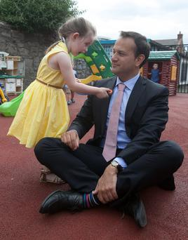 Minister for Health, Leo Varadkar and Isabelle Heapes (3) from Macken Street at the launch of the online registration system for the new Free GP Care for Children Under 6 at St. Andrew's Resource Centre, Pearse Street, Dublin.