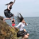 Abbie McDonald and Nicola Borza from the Teresian School, Donnybrook, take a dip in Sandycove in Dublin