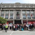 Clerys workers protest outside the front of the Clerys Department store which closed its doors last Friday