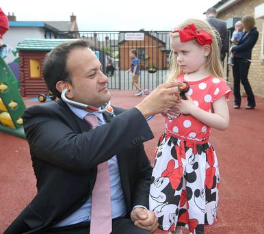 Health Minister Leo Varadkar with Kiya O'Connor (3) from Macken Street, Dublin, at the launch of the online registration system for the new free GP care on Pearse Street. Photo: Damien Eagers