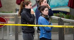 Onlookers at the scene of the balcony collapse, in which six Irish students died, in Berkeley, California, USA