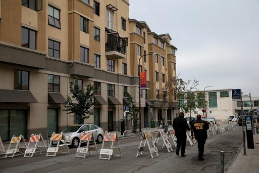 Police at the sealed-off scene in Kittredge Street, Berkeley, California, where six Irish students lost their lives when a balcony collapsed while they were having a party
