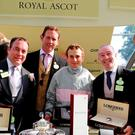 The Act Da Wag Syndicate, with jockey Ryan Moore, after their win, L-R: Michael Gannon, David Cox, David Casey and Ruby Walsh.