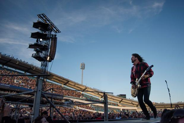 Foo Fighters band member Dave Grohl performs during the band's concert at Nya Ullevi in Gothenburg, Sweden, June 12, 2015, before falling off the stage