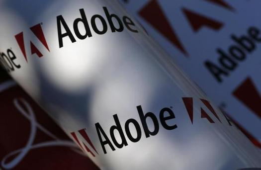 Adobe company logos are seen in this picture illustration taken in Vienna July 9, 2013. Picture taken July 9, 2013. To match Special Report TAX-BIGTECH/ REUTERS/Leonhard Foeger