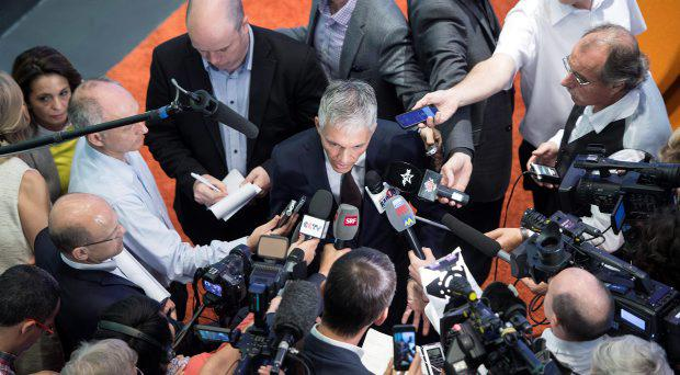 Swiss attorney general Michael Lauber, center, speaks to journalists after a press conference in Bern, Switzerland, Wednesday, June 17, 2015
