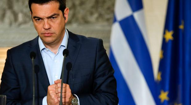 Greek Prime Minister Alexis Tsipras gestures during a news conference with Austrian Chancellor Werner Faymann at Maximos Mansion in Athens June 17, 2015. REUTERS/Paul Hanna