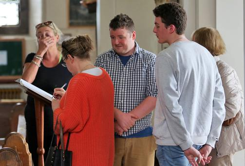 People sign the Book of Condolences which was opened for the victims of the California balcony collapse at Our Lady of Perpetual Succour Church, Foxrock this afternoon...Picture Colin Keegan, Collins Dublin.