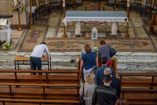 Wednesday 17 June 2015. The chapel in St. Mary's CCCP, Rathmines. People sign the book of condolence.