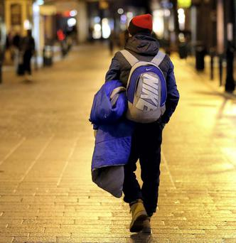 A homeless man walking on Dublin's Grafton Street
