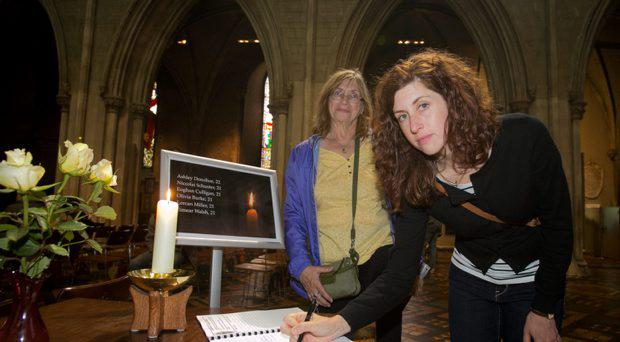 Denice Hurlebaus with daughter Kathleen Hurlebaus both from Wisconsin signing a book of Condolence at St. Patricks Cathedral, Dublin in memory of the 6 Irish students who died following a balcony collapsing in San Francisco, California. Photo: Gareth Chaney Collins