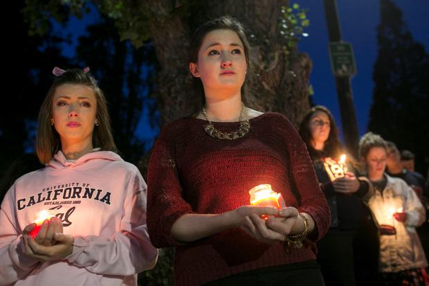 Women hold candles during a candlelight vigil for the victims of the Berkeley balcony collapse in Berkeley, California June 17, 2015. Three men and three women in their early 20s, including an American friend of the Irish students, died in the collapse, and seven others were hospitalized. REUTERS/Elijah Nouvelage