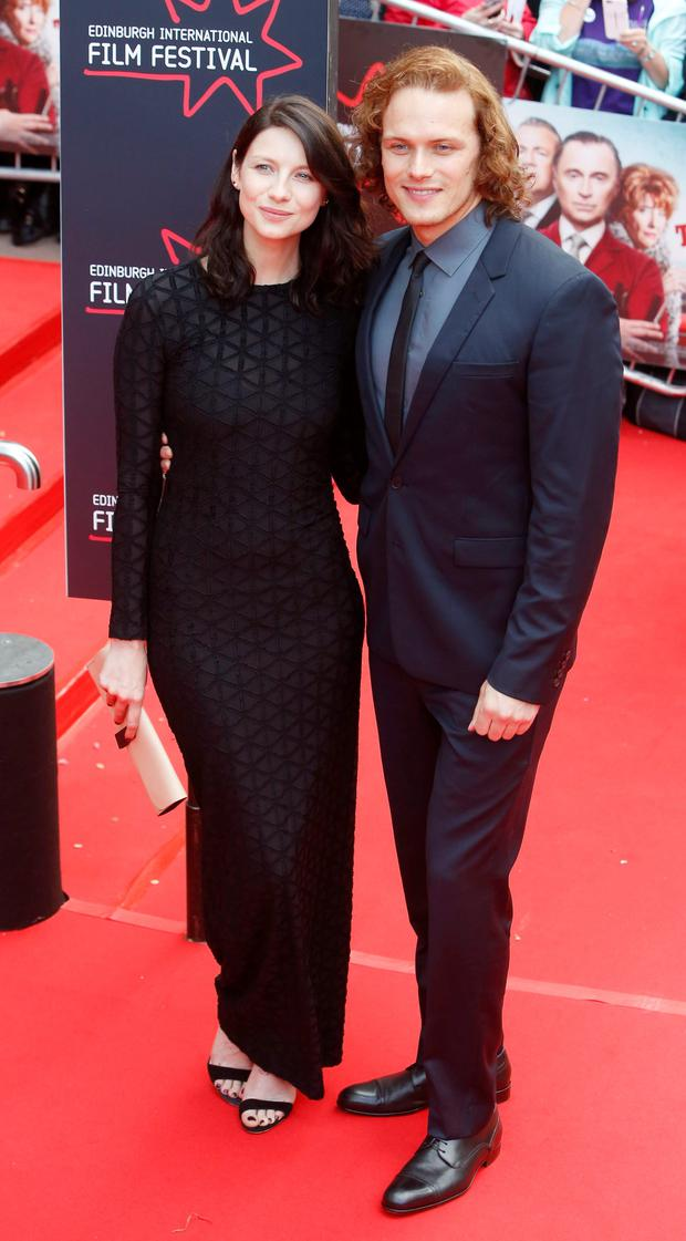 Caitriona Balfe and Sam Heughan (right) arriving for the screening of The Legend of Barney Thomson on the opening night of the Edinburgh International Film Festival.