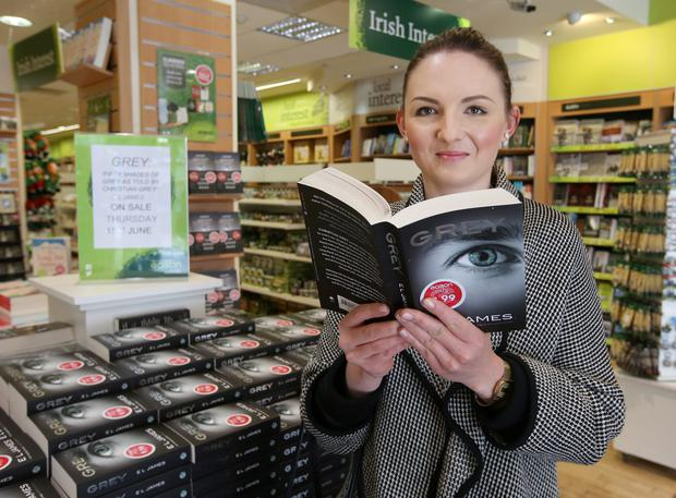 Kinga pilichowska, from Dublin, holds a copy of E.L. James' new Grey; Fifty Shades of Grey book at Easons in O'Connell St, Dublin