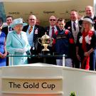Queen Elizabeth II presents the Gold Cup to winner Graham Lee
