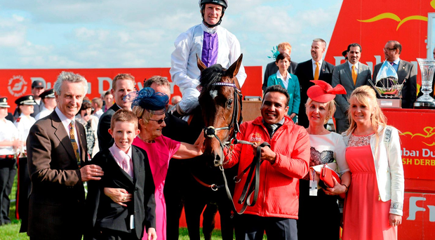 Jim Bolger celebrates Trading Leather's victory in 2013 Dubai Duty Free Irish Derby with, left to right, James Manning, Jackie Bolger, jockey Kevin Manning, groom Mohammed Abid Ghaffour, Una Manning and Claire Manning. Photo: Sportsfile