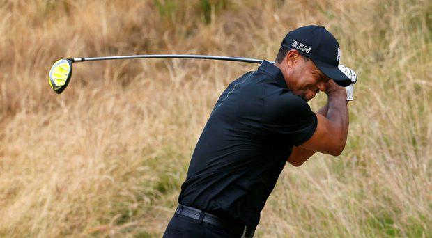 Tiger Woods reacts to his tee shot on the eighth hole during the first round of the U.S. Open golf tournament at Chambers Bay on Thursday, June 18, 2015 in University Place, Wash. (AP Photo/Matt York)
