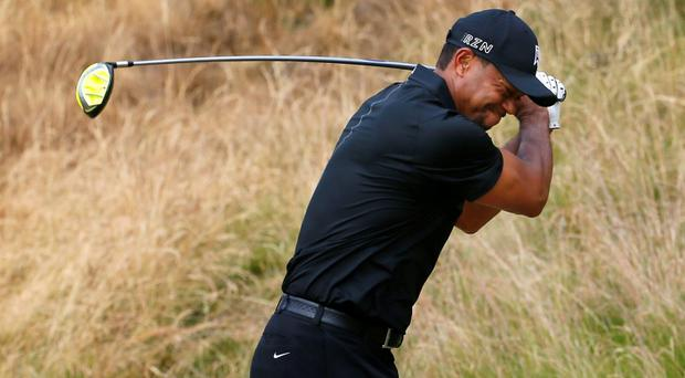 Tiger Woods reacts to his tee shot on the eighth hole during the first round of the U.S. Open golf tournament at Chambers Bay