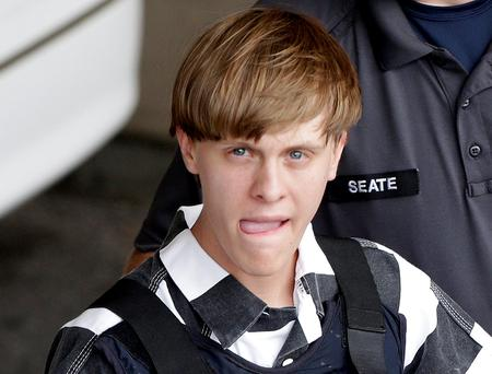 Charleston, S.C., shooting suspect Dylann Storm Roof is escorted from the Cleveland County Courthouse in Shelby, N.C., Thursday, June 18, 2015